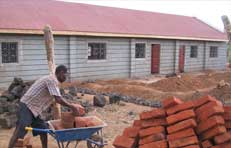 Picture of a man helping to build the Kisayani unit