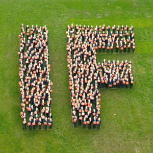 People standing in the shape of IF shot from above