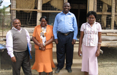 Staff standing outside the Mitaboni Primary School