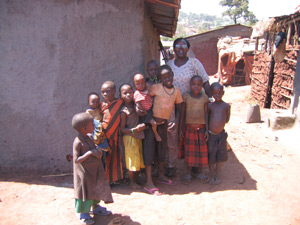Project worker Rosemary with children from the slum