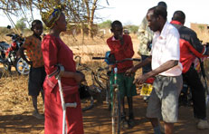 Women with crutches at village meeting